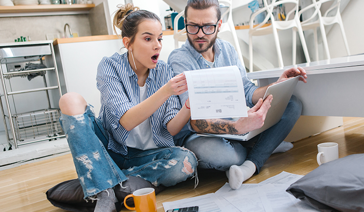 A couple budgeting and discovering their partners debt after they talked about money